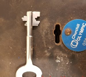 Double bitted pipe key and matching keyhole, Alan Morgan Master Locksmiths